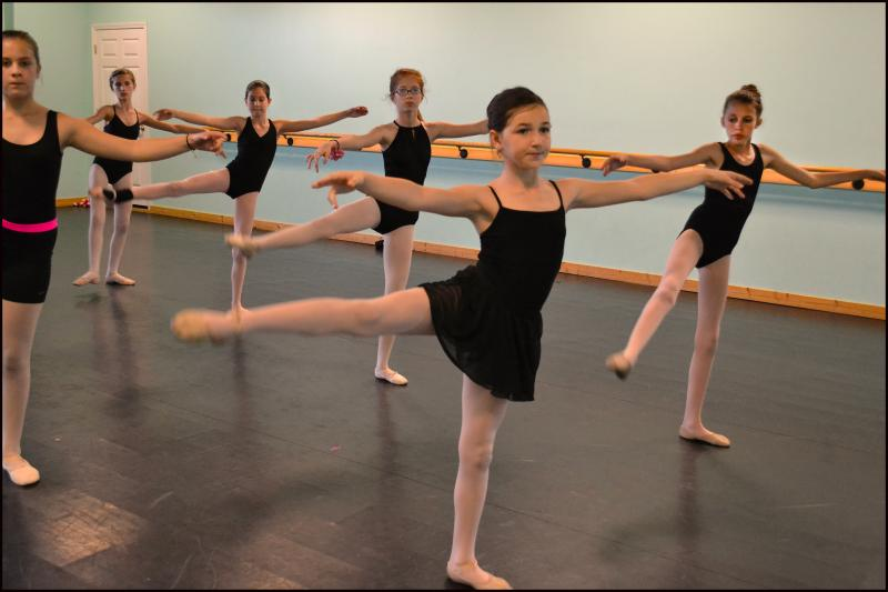 Preteen students enjoy learning ballet, hip hop, jazz, & contemporary dance